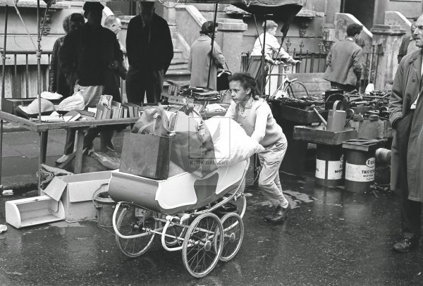 Girl with pram black and white photo taken in 1950s portobello road market