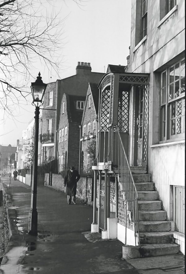 man walking in chiswick 1950s black and white photograph