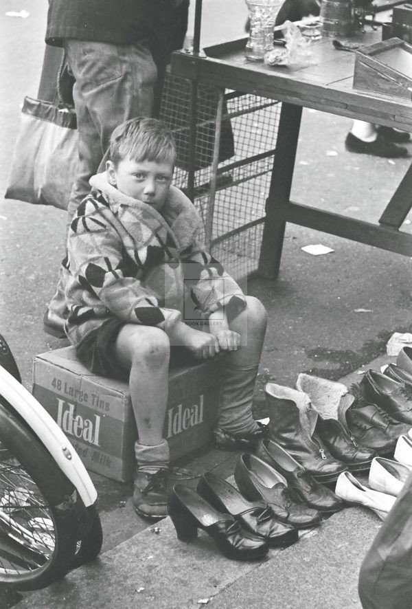 little boy waiting at the market stall London 1950s