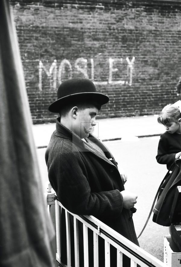 young boy next to Mosley graffiti London 1950s
