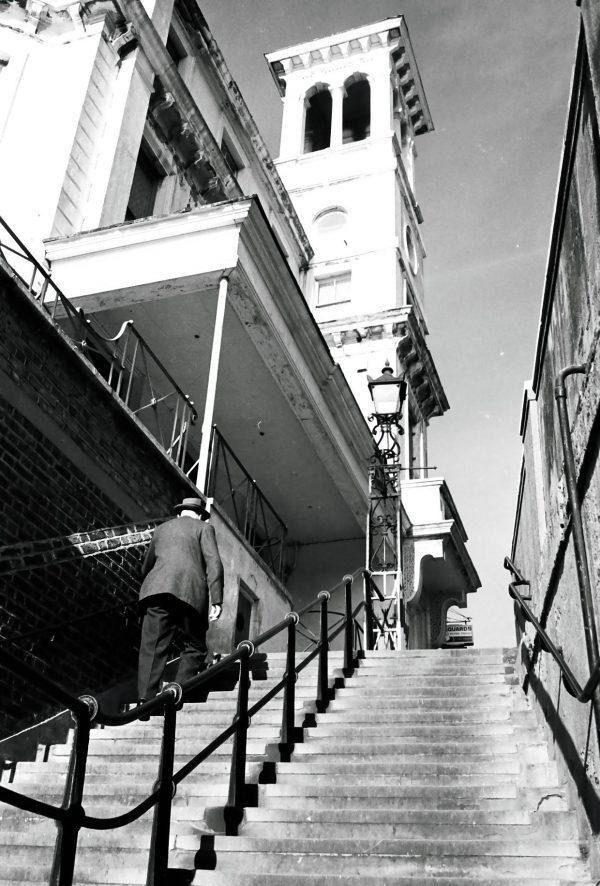 man walking up London staircase to church 1950
