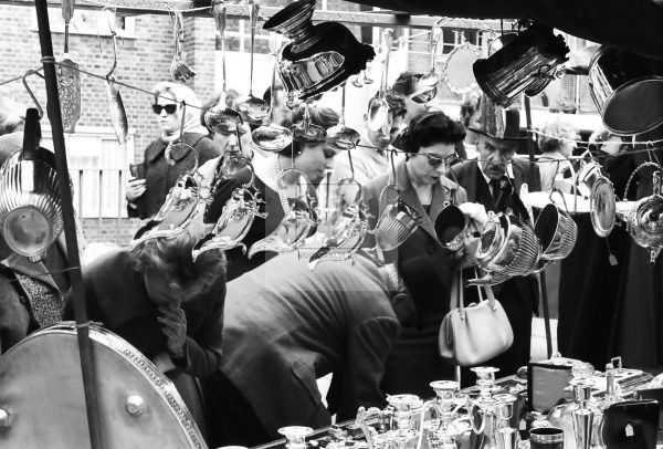 lady at market stall with glasses on 1950s London