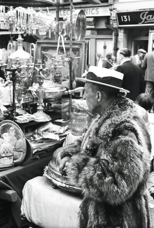 antique seller man in fur coat London market 1950s