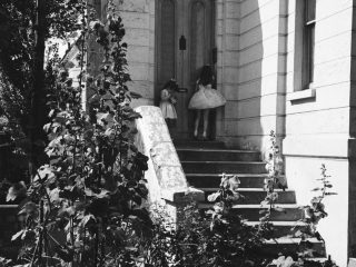 Two young girls in ballerina outfits outside of house 1950s London