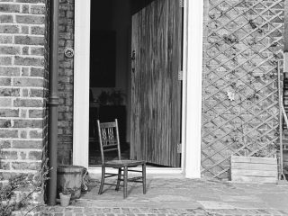 wooden chair infront of 1950's London house