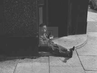 boy outside London pub with pint 1950s