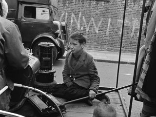 young boy sat on stall market London